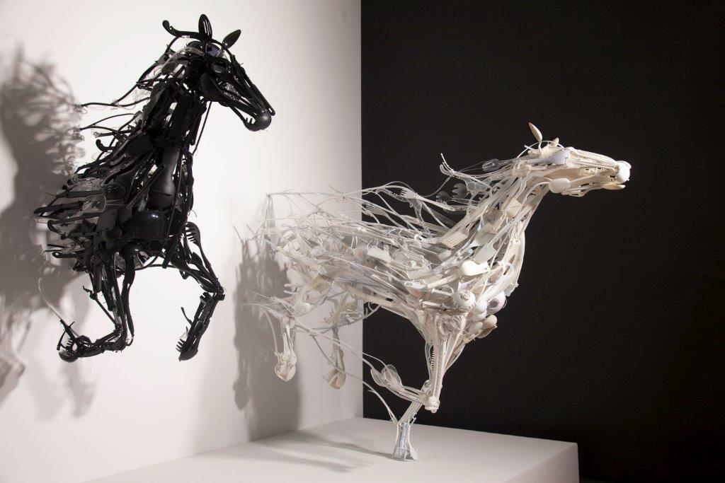 <B><i>Emergence</b></i>, 2013; reclaimed plastic objects, painted steel and aluminum, hardware, wire, cable ties; 6 x 7 x 7 feet