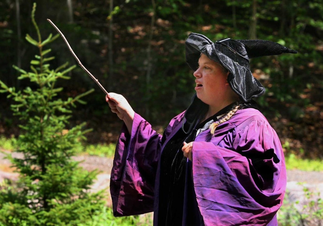 Professor Quickwit, played by Stamford Museum & Nature Center Director of Education Lisa Monachelli, teaches kids how to use their magic wands during a potions class as part of a Wizard Picnic to celebrate Harry Potter's birthday on the grounds in Stamford, Conn., on Saturday July 31, 2021. Kids came dressed as wizards and took part in several activities like making their own wands, a potions class, a visit with some magical creatures from the nature center and snacks.